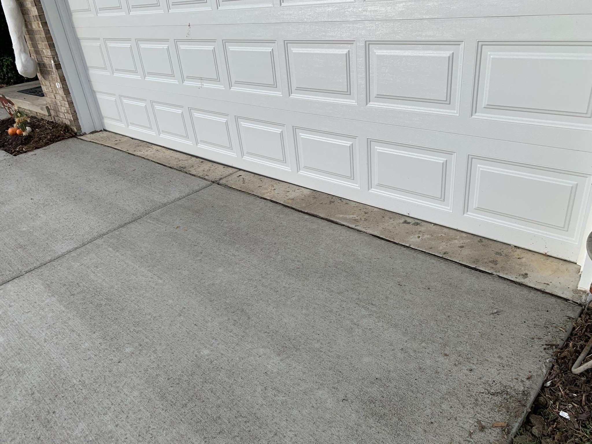 freah concrete driveway before it has dried